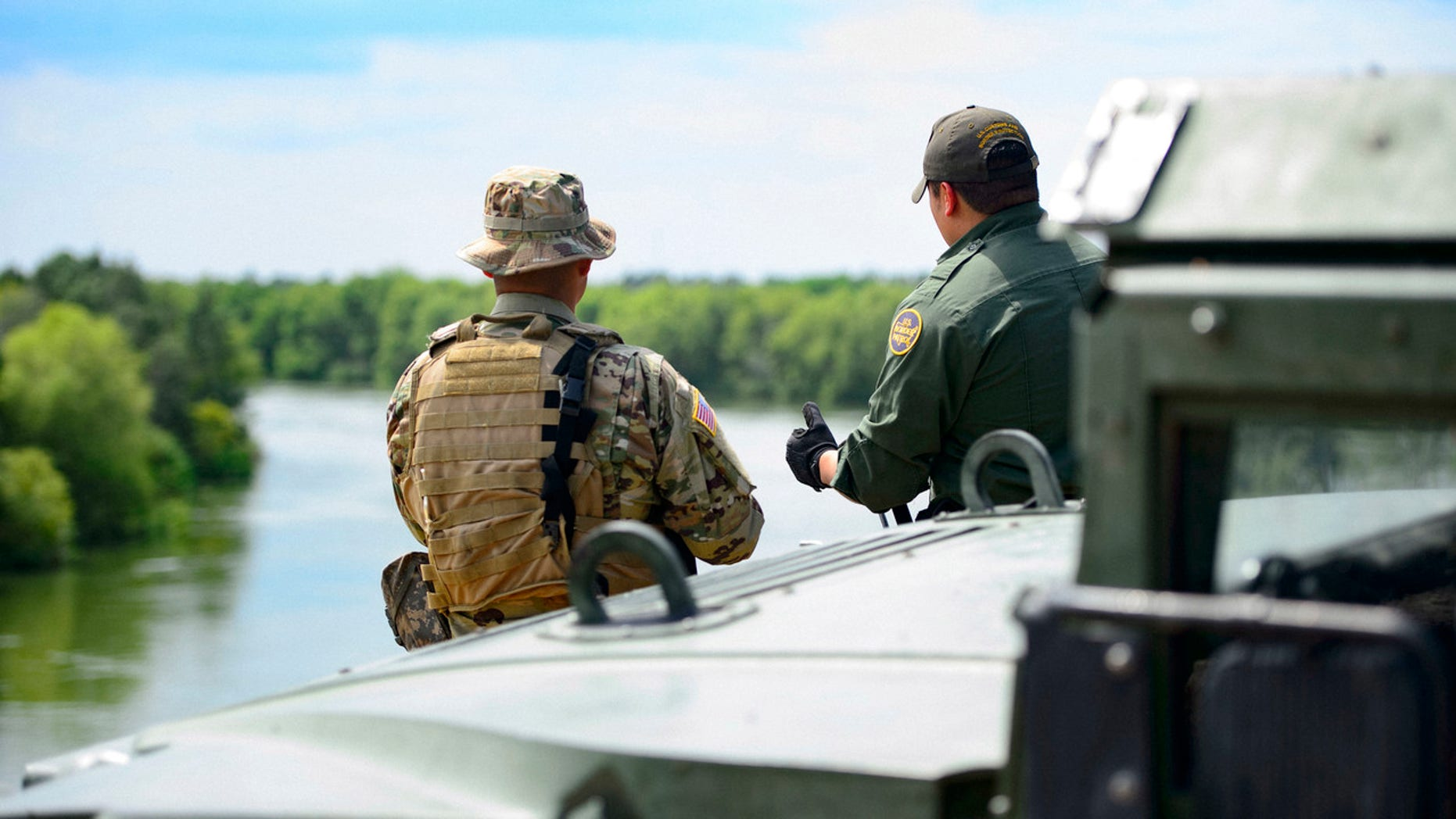 FILE: A Texas Guardsmen and a Customs and Border Patrol agent in Texas. Border Patrol