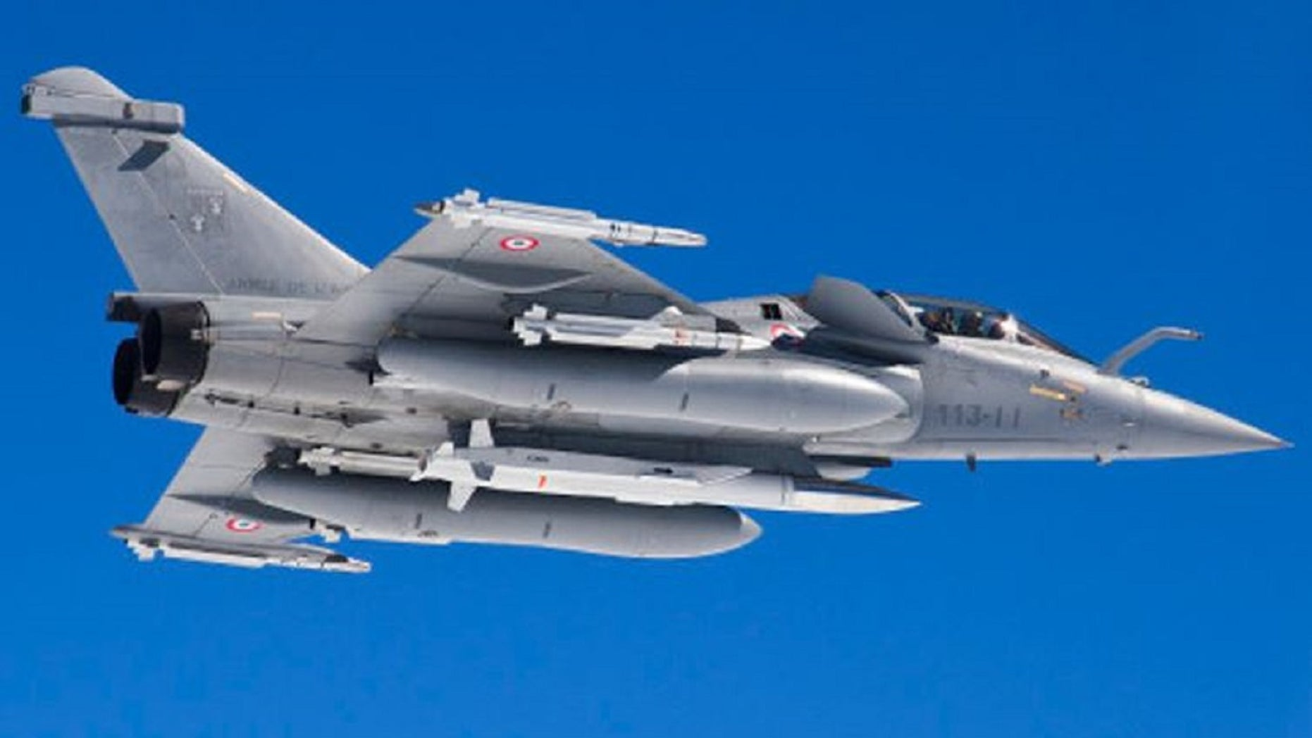 A French Rafale fighter jet equipped with nuclear cruise missiles.