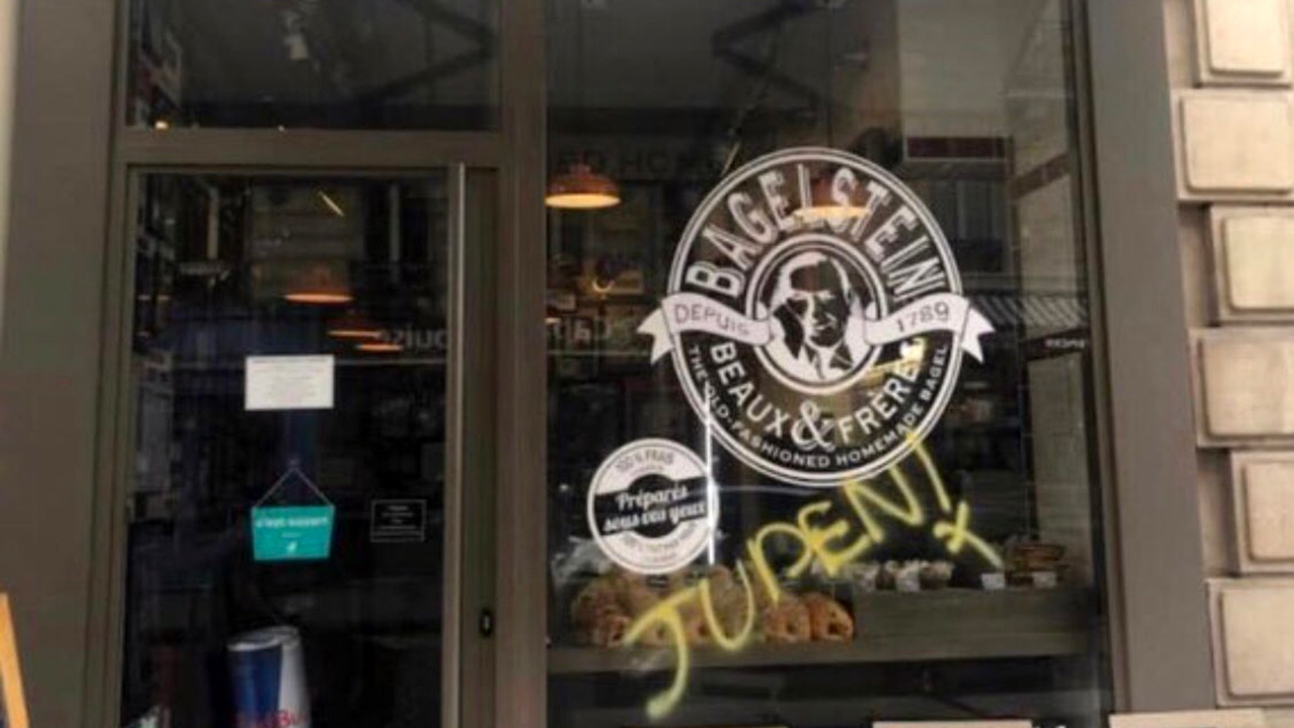 Anti-Semitic graffiti was discovered on a bagel shop in Paris on Saturday, as police forces and anti-government protesters clashed in other parts of the city.