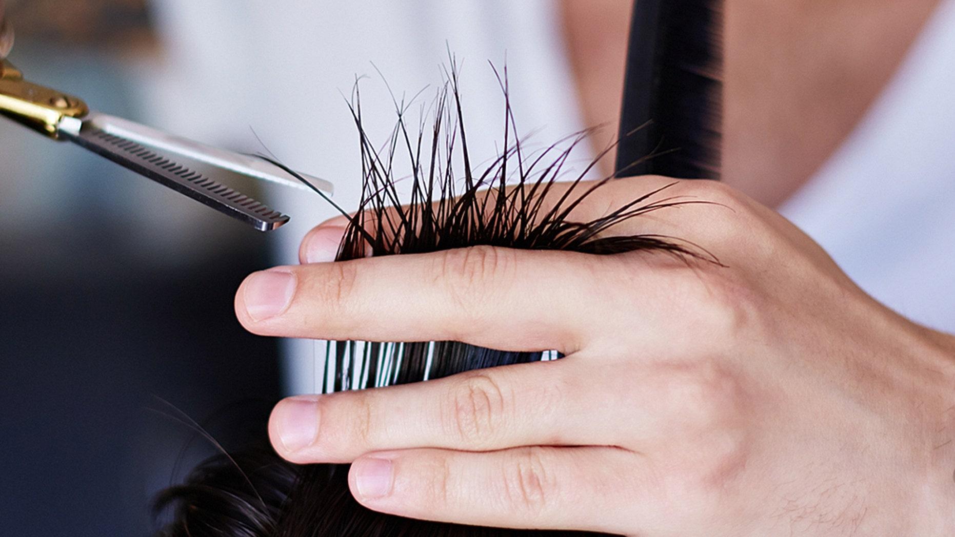 A mother claimed a teacher cut her son's hair.