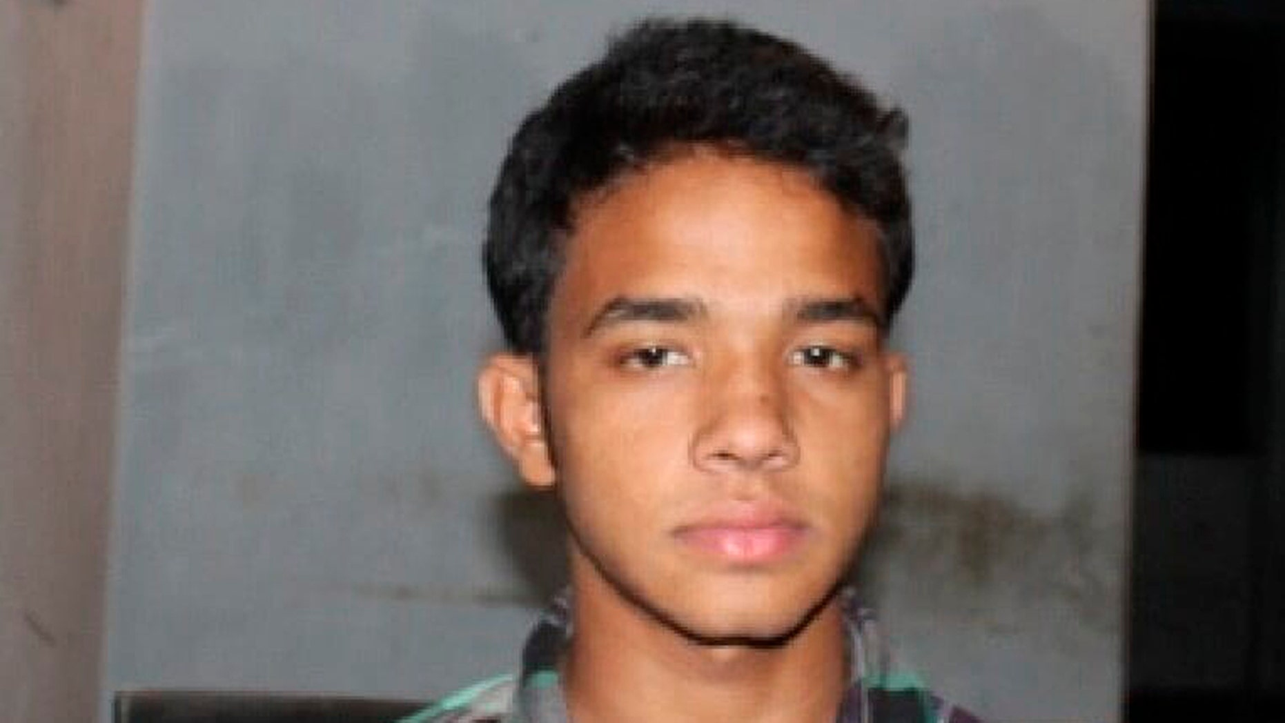This photograph released Monday by Bangladesh' Rapid Action Battalion (RAB) from their criminal database shows Bangladeshi youth Mohammed Polash Ahmed who was arrested in 2012 by RAB in a kidnapping case.