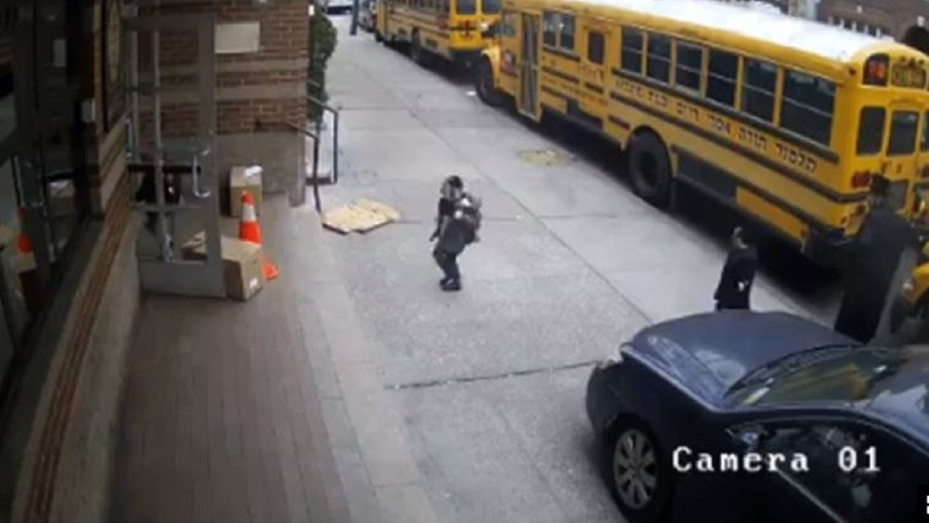 Former NY State Assemblyman Dov Hikind released video of what appears to be a driver trying to get around several parked school buses by driving onto the sidewalk.