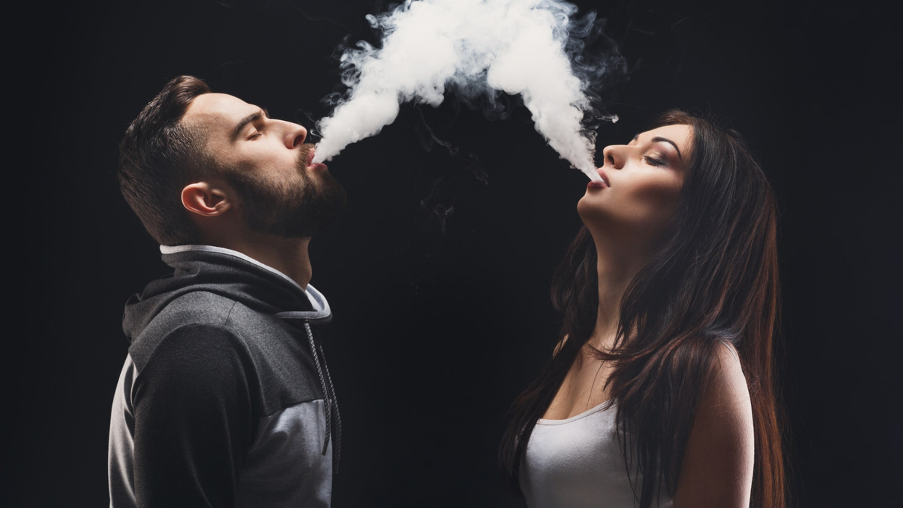 Vaping seems to be the new wedding photo trend for young couples.