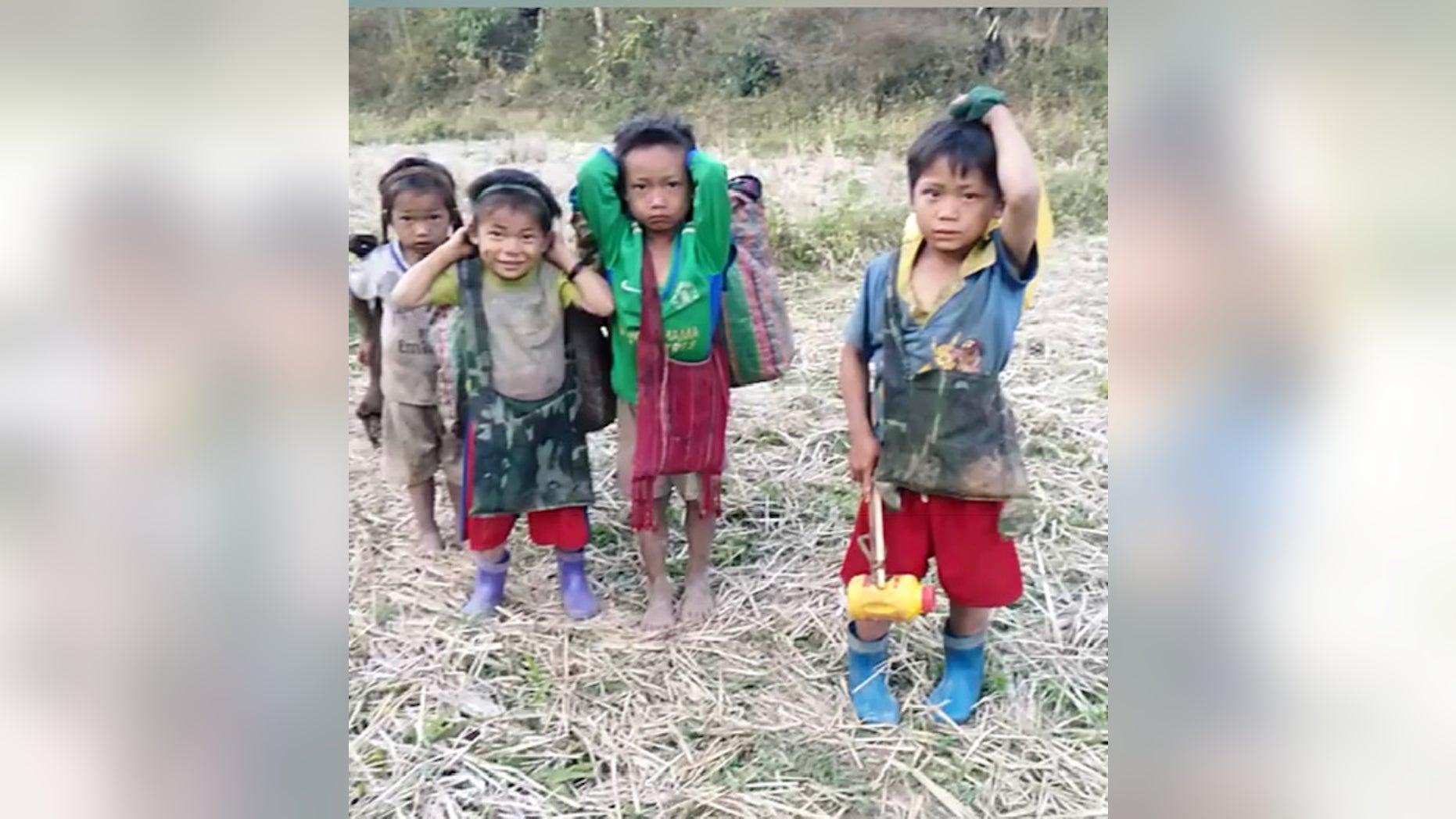 Karen children flee their homes in Burma on January 25, 2019