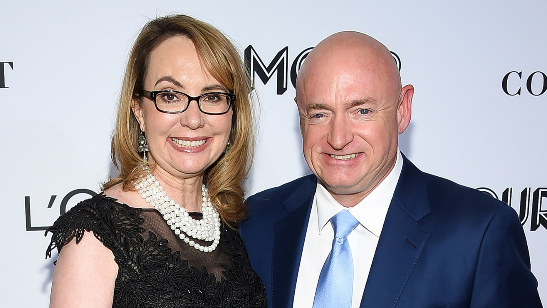 FILE- In this Nov. 12, 2018, photo, Gabrielle Giffords and husband, retired astronaut Mark Kelly, attend the Glamour Women of the Year Awards at Spring Studios in New York. (Photo by Evan Agostini/Invision/AP, File)