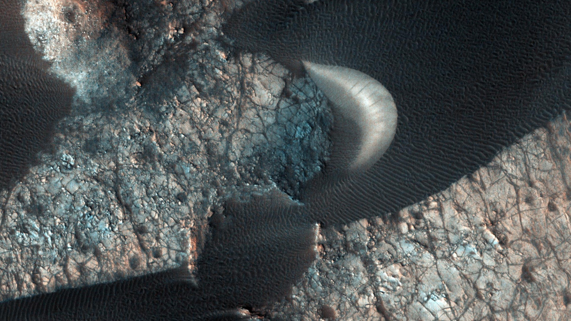 Sand dunes are seen on Mars in this image released by NASA.
