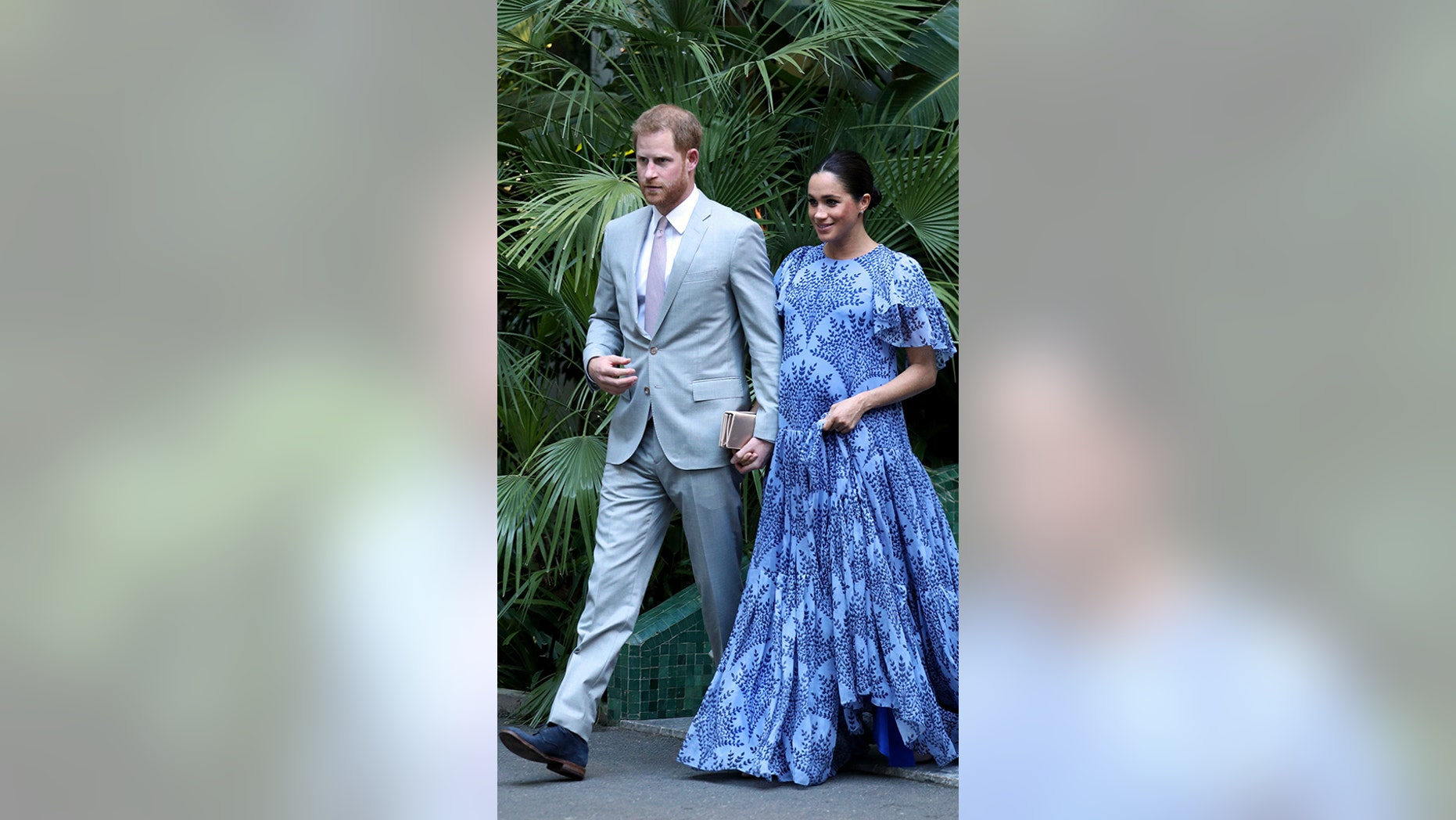 Britain's Prince Harry, left and Meghan, the Duchess of Sussex, leave the residence of Mohammed VI of Morocco, on the third day of their tour of Morocco, in Rabat, Monday, Feb. 25, 2019.