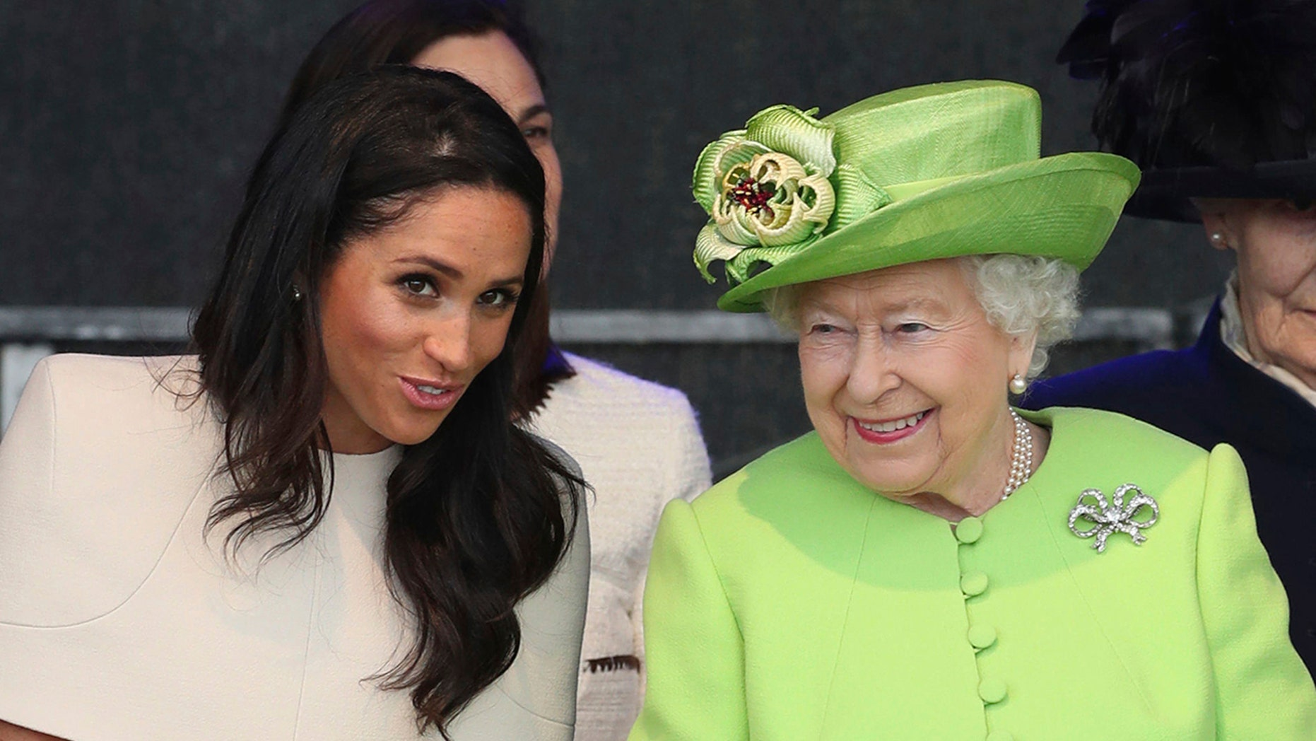 Queen Elizabeth II and Meghan, Duchess of Sussex, on the left, attend the unveiling of the new Mersey Gateway Bridge, in Widnes, North West England, on Thursday. June 14, 2018.