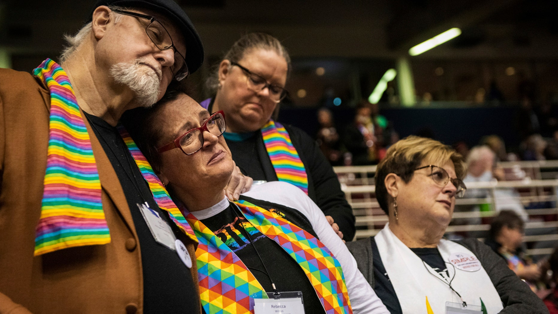 Ed Rowe, left, Rebecca Wilson, Robin Hager and Jill Zundel, react to the defeat of a proposal that would allow LGBT clergy and same-sex marriage within the United Methodist Church at the denomination's 2019 Special Session of the General Conference in St. Louis.