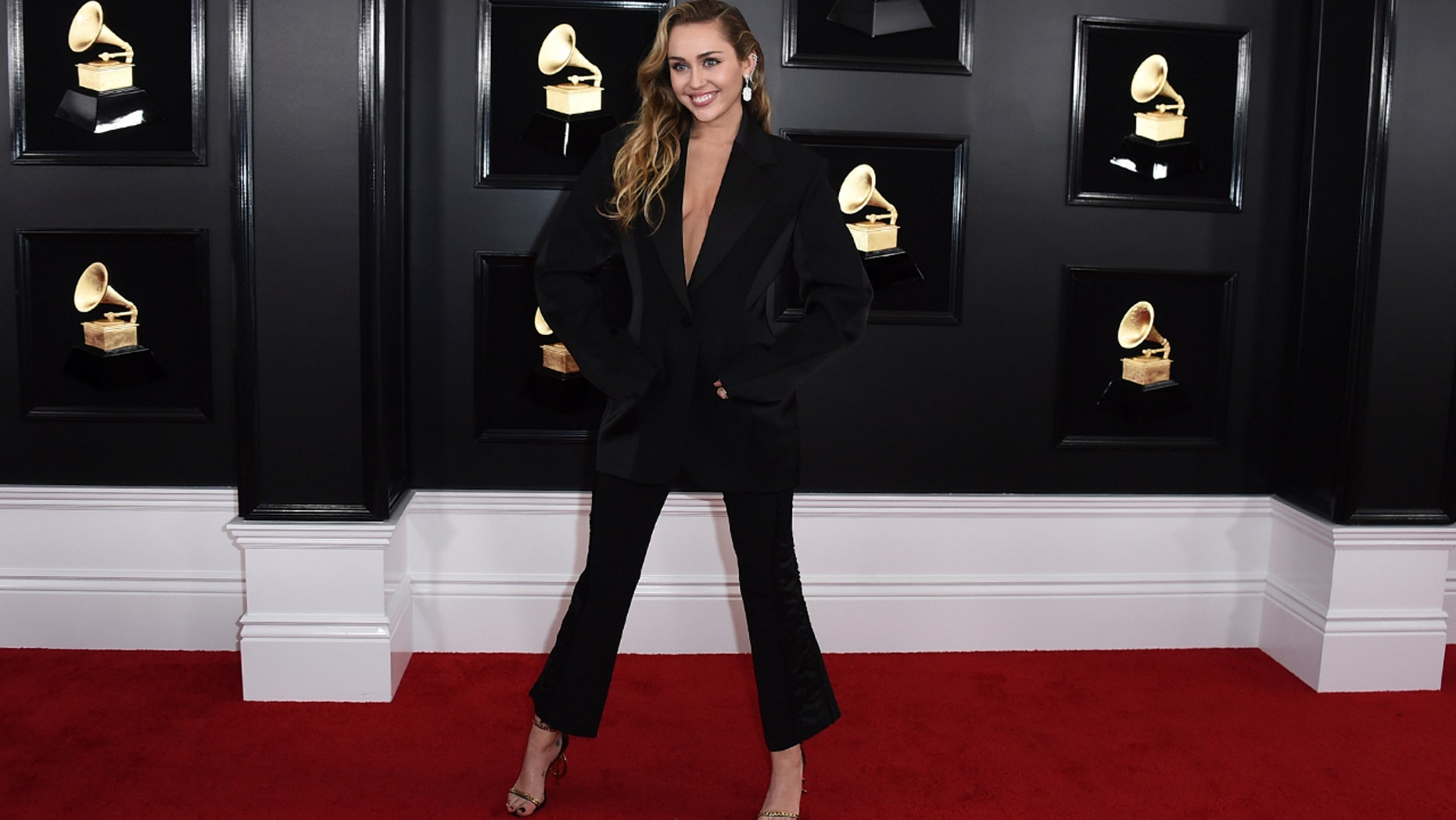 "Miley Cyrus arrives at the 61st Annual Grammy Awards at Staples Center on Sunday, February 1<div class=""e3lan e3lan-in-post1""><script async src=""//pagead2.googlesyndication.com/pagead/js/adsbygoogle.js""></script>