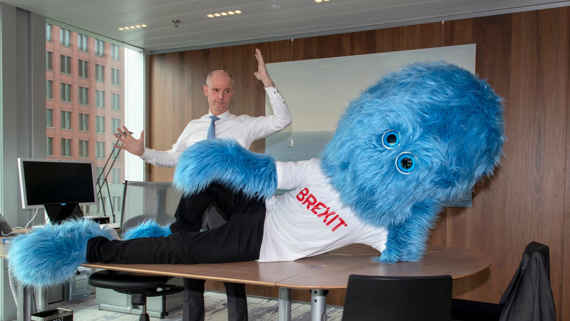 "Foreign Minister Stef Blok tweeted the picture of a giant monster mascot laying on his desk sporting a ""Brexit"" T-shirt. ""Make sure Brexit doesn't sit – or lie – in your way,"" Blok wrote."