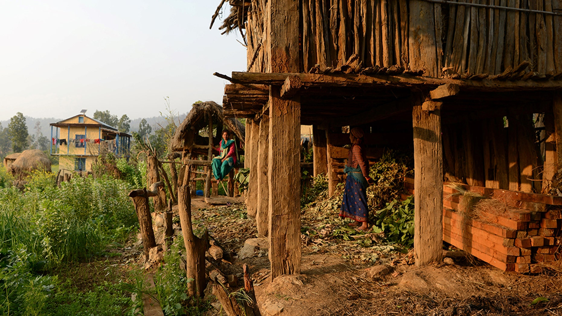 In this photograph taken on February 3, 2017, Nepalese woman Yum Kumari Giri looks at a Chhaupadi hut during her menstruation period in Surkhet District, some 520km west of Kathmandu.
