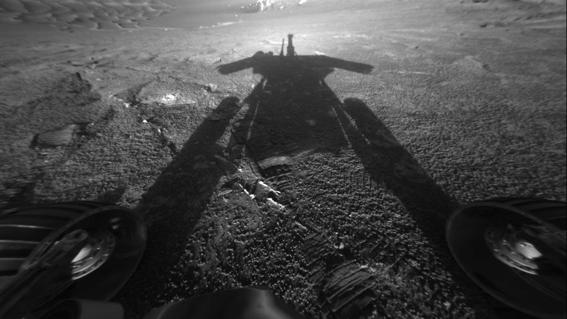 NASA's Mars rover Opportunity reveals its shadow, seen on July 26, 2004, and snapped by the rover's front hazard-avoidance camera. At the time, Opportunity was moving farther into Endurance Crater in the Meridiani Planum region of Mars.