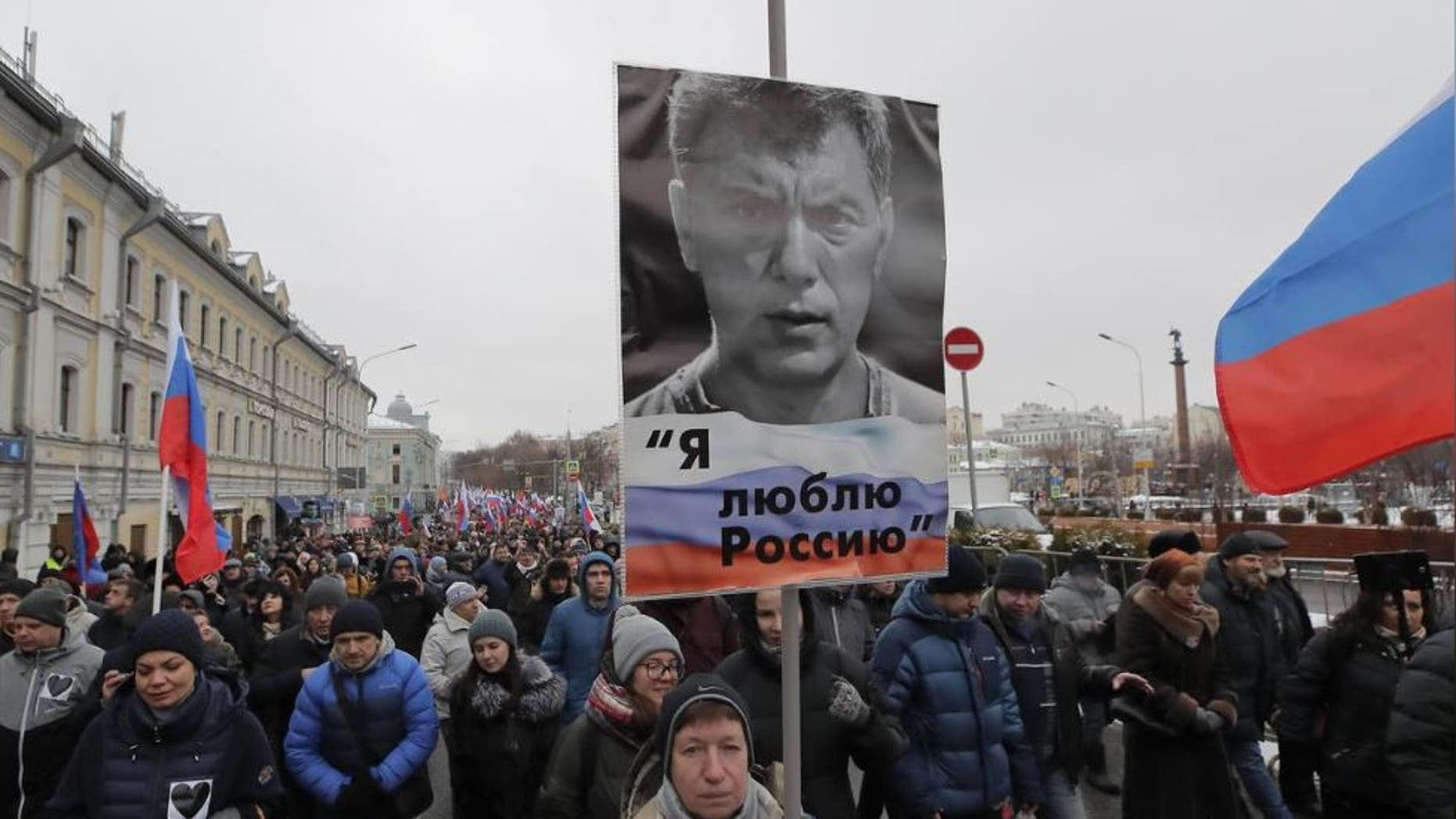 "People attend a rally in memory of Russian opposition politician Boris Nemtsov, who was assassinated in 2015, in Moscow, Russia February 24, 2019. The placard reads ""I love Russia""."