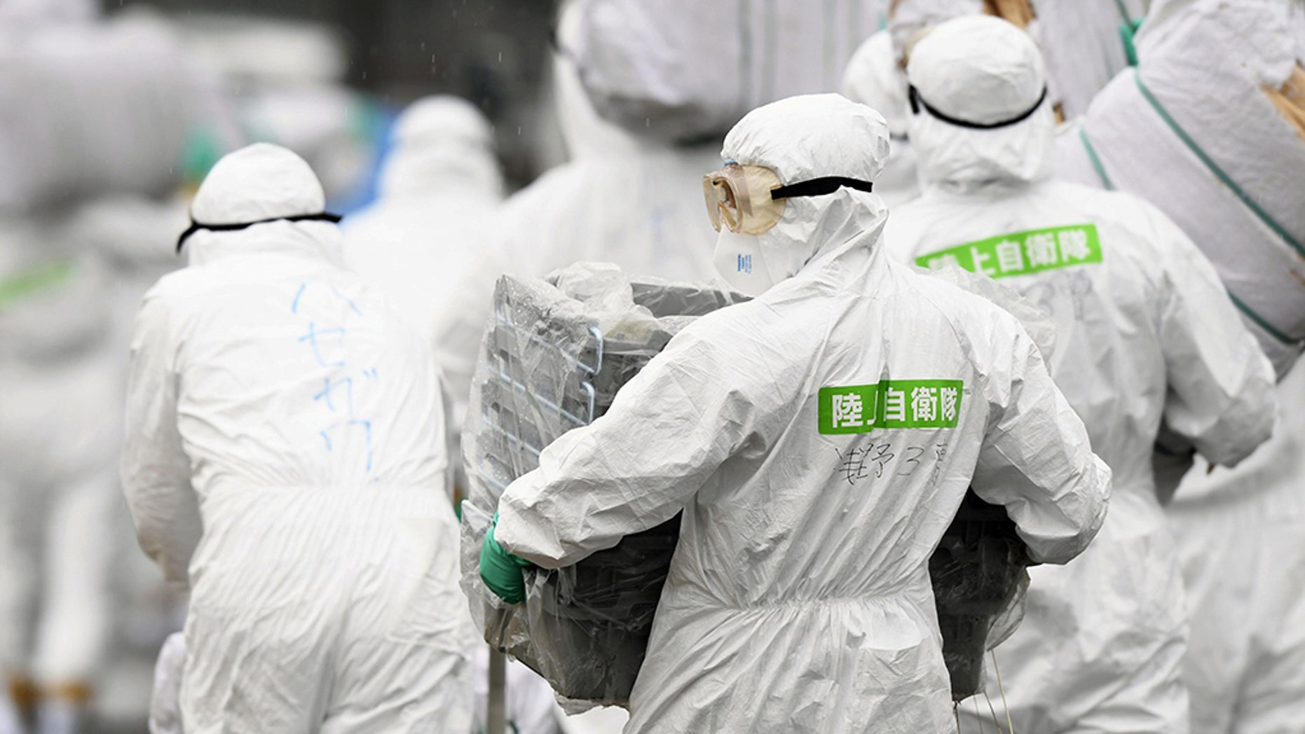 Members of the Japan Self-Defense Forces (JSDF) undergo a quarantine operation at a hog farm after an outbreak of swine fever was detected, in Toyota, Aichi Prefecture, Japan.