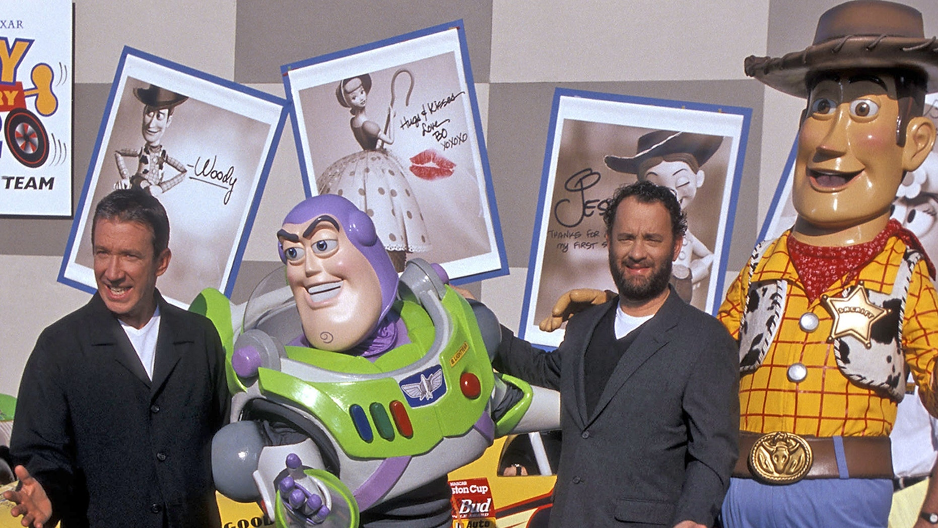 """Tim Allen and Tom Hanks with their """"Toy Story"""" characters Buzz Lightyear and Woody"""