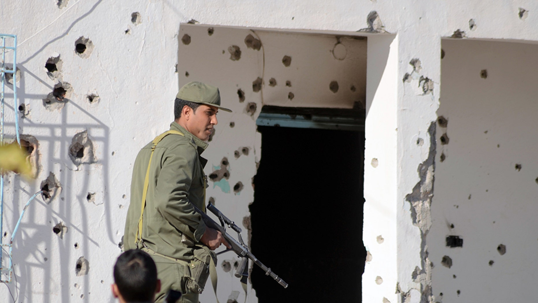 A member of the Tunisian special forces stands outside a bullet-riddled house in the southern town of Ben Guerdane, near the Libyan border, during clashes with jihadists in 2016.