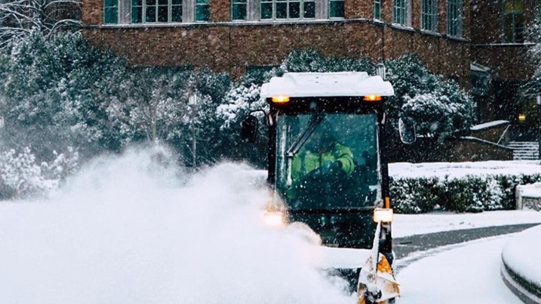 A plow is seen on the University of Washington campus after a snow storm.