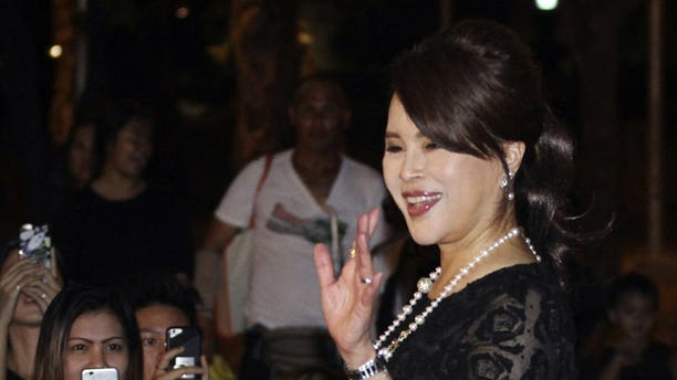 In this Oct 27, 2017, photo, Thai Princess Ubolratana Mahidol waves to Thai people outside Grand Palace in Bangkok , Thailand. The selection of the elder sister of Thailand's king as a political party nominee for prime minister has upended a tradition of the palace playing no public role in politics. Most but not all modern monarchies steer clear of direct involvement in electoral politics or governing.