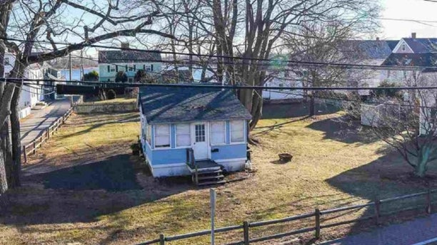 A tiny New Hampshire cottage sitting on less than half an acre of land is on the market for $2 million.