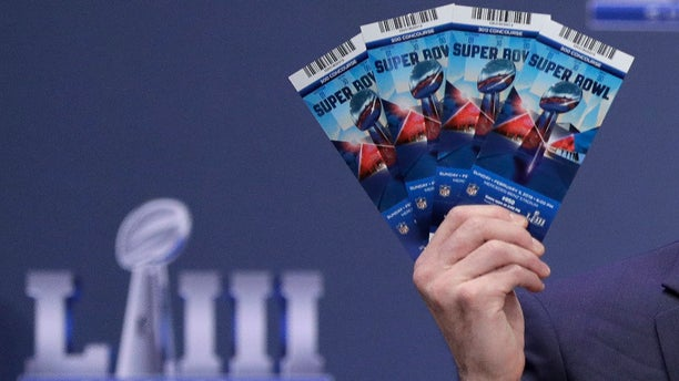 Michael, Buchwald, NFL senior counsel, legal, holds up Super Bowl LIII tickets as he explains the security features on the tickets during a news conference, Jan. 31, 2019, in Atlanta. (Associated Press)