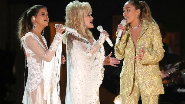 """Maren Morris, from left, Dolly Parton and Miley Cyrus perform """"After The Goldrush"""" at the 61st annual Grammy Awards on Sunday, Feb. 10, 2019, in Los Angeles."""