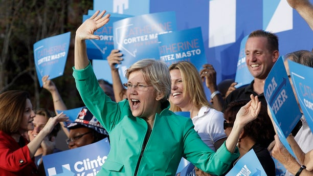 FILE - Sen. Elizabeth Warren, D-Mass., was briefly heckled during a campaignrally in Georgia over her Native American ancestry claims.(AP Photo/John Locher, File)