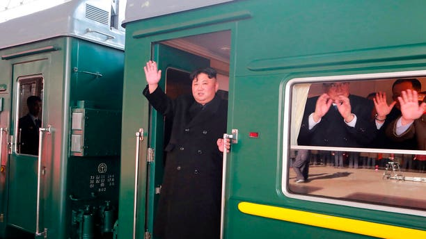 "In this Saturday, Feb. 23, 2019, photo provided on Sunday, Feb. 24, 2019, by the North Korean government, North Korean leader Kim Jong Un waves from a train before leaving Pyongyang Station, North Korea, for Vietnam. Kim was on a train Sunday to Vietnam for his second summit with U.S. President Donald Trump, state media confirmed. Independent journalists were not given access to cover the event depicted in this image distributed by the North Korean government. The content of this image is as provided and cannot be independently verified. Korean language watermark on image as provided by source reads: ""KCNA"" which is the abbreviation for Korean Central News Agency. (Korean Central News Agency/Korea News Service via AP)"
