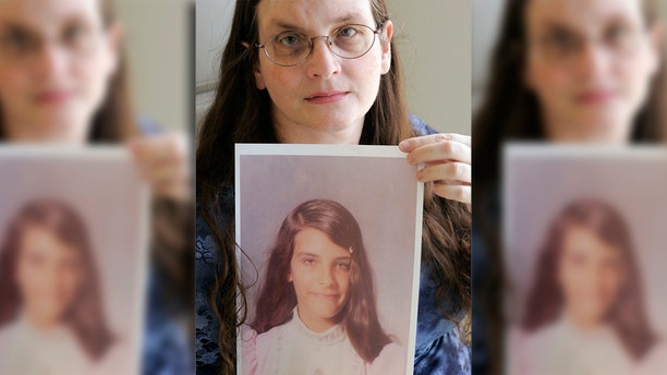 Hundreds of leaders and volunteers within Southern Baptist churches nationwide have been accused of sexual misconduct. Debbie Vasquez is pictured holding a photo of herself at age 14, when she said her pastor first molested her.