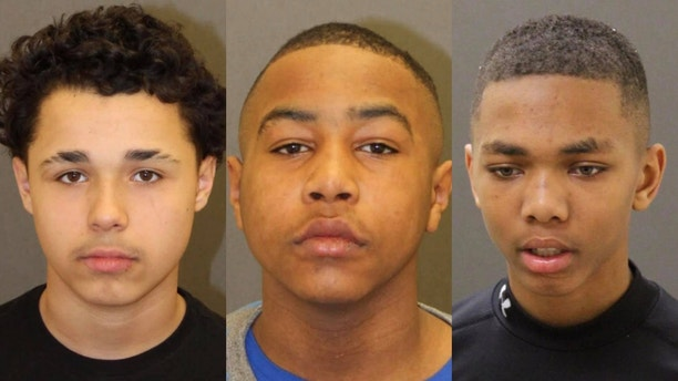 From the left, Wilmer Ramos, Philip Worrell, and Nile Campbell were charged as adults with first- and second-degree rape. They are 14 years old.