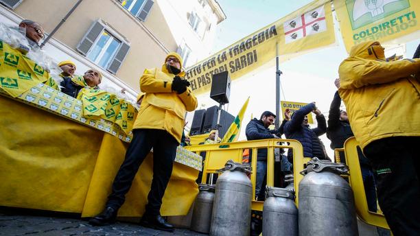 Sardinians dairy farmers protest low milk prices in downtown Rome, Italy, Tuesday, Feb. 12, 2019. (Giuseppe Lami/ANSA via AP)