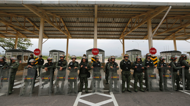 Venezuelan Bolivarian Guardsmen stand guard at the Tienditas International Bridge that links Colombia and Venezuela, near Urena, Venezuela, Friday, Feb. 8, 2019. As humanitarian aid kits were being packed into individual white bags in the city of Cucuta, just across the river from Venezuela, U.S. officials and Venezuelan opposition leaders appealed to the military to the let the aid through. (AP Photo/Fernando Llano)