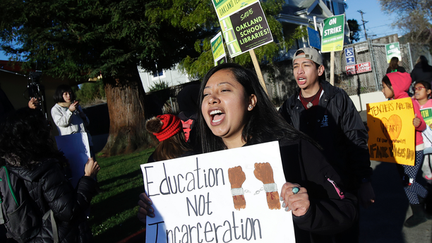 Roxana De La O Cortez, teacher at Manzanita SEED Elementary School, marches with other teachers and supporters in Oakland, Calif., Thursday, Feb. 21, 2019. Teachers in Oakland went on strike Thursday in the country's latest walkout by educators over classroom conditions and pay. (AP Photo/Jeff Chiu)
