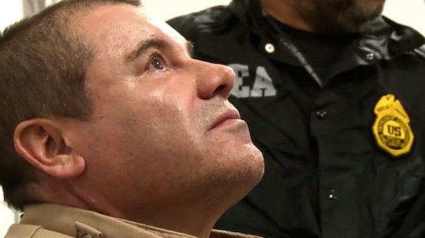 """In this Jan. 19, 2017 photo provided by the United States Drug Enforcement Administration, Mexican drug kingpin Joaquin """"El Chapo"""" Guzman arrives at Long Island MacArthur Airport in Ronkonkoma, N.Y., after being extradited to the United States to face drug trafficking charges. Guzman, was convicted Tuesday, Feb. 12, 2019, of running an industrial-scale smuggling operation after a three-month trial packed with Hollywood-style tales of grisly killings, political payoffs, cocaine hidden in jalapeno cans, jewel-encrusted guns and a naked escape with his mistress through a tunnel. (United States Drug Enforcement Administration via AP)"""