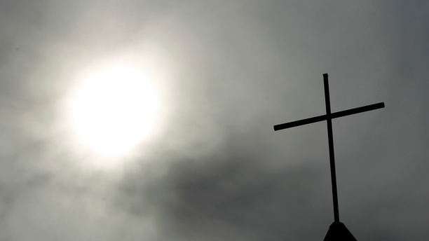 A cross sits on top of a church in Berlin, Germany. Pope Francis' high-stakes sex abuse prevention summit is meant to call attention to the crisis as a global problem that requires a global response. (AP Photo/Markus Schreiber, File)