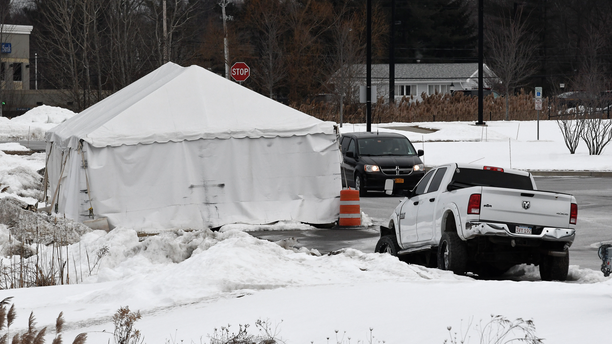 FILE - This Jan. 29, 2019, file photo shows a view of tent structure housing the wrecked limousine owned by Prestige Limousine involved in the Oct. 6, 2018, fatal accident in Schoharie County, behind the state police headquarters in Latham, N.Y. The National Transportation Safety Board's probe of a fatal limousine crash in upstate New York has not yet identified a cause, according to a preliminary report released Monday, Feb. 11, after weeks of wrangling between federal inspectors and a local prosecutor over access to physical evidence. (AP Photo/Hans Pennink, File)