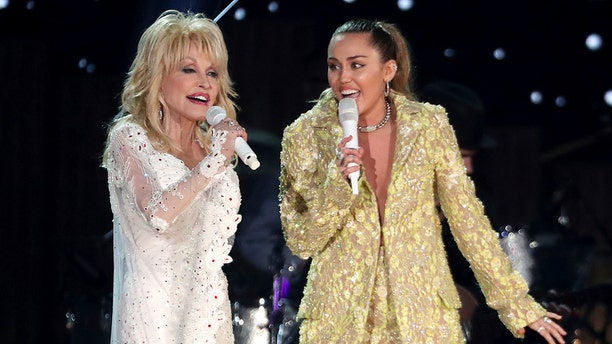 """Dolly Parton, left, with her goddaughter Miley Cyrus, performing """"Jolene"""" at the 61st annual Grammy Awards on Sunday, Feb. 10, 2019, in Los Angeles."""