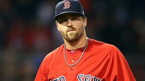 Heath Hembree of the Boston Red Sox looks on during a game against the Baltimore Orioles.