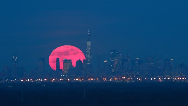 The super snow moon, which is the largest supermoon of 2019, rises behind lower Manhattan and One World Trade Center in New York City on Feb. 19, 2018 as seen from Green Brook Township, New Jersey. (Gary Hershorn/FOX News)