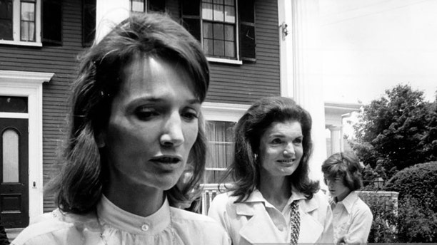 Jacqueline Kennedy Onassis (R) and her sister Lee Radziwill exit after Caroline Kennedy's Graduation from Concord Academy on June 5, 1975 in Concord, Massachusetts. (Photo by PL Gould/Images Press/Getty Images)