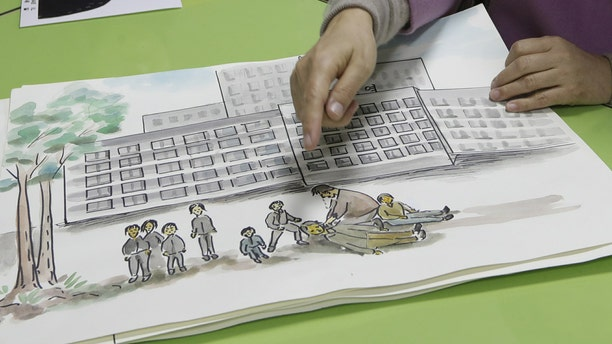 In this Dec. 21, 2018, photo, North Korean defector Kwak Jeong-ae, 65, shows a drawing about North Korea during an interview in Uijeongbu, South Korea. Experts and defectors say most of North Korea's underground Christians do not engage in the extremely dangerous work of proselytizing. Instead, they largely keep their beliefs to themselves or within their immediate families.