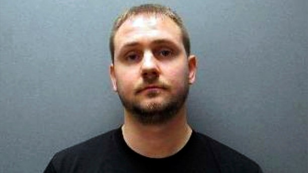 This undated booking photo released by Johnson County Sheriff's Office shows Nicholas Bridgmon. The Nebraska sheriff's deputy charged with sexually assaulting a woman more than a decade ago now is linked to at least five other victims before he joined the department in 2015. (Johnson County Sheriff's Office via AP)