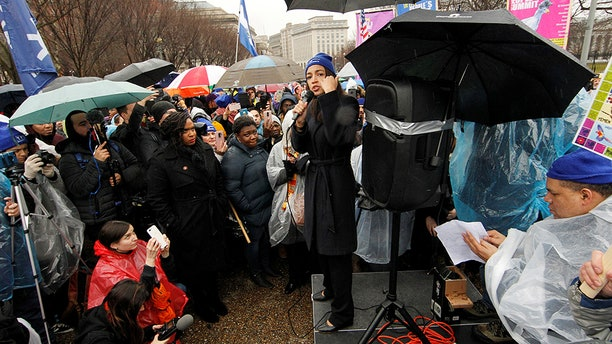 """U.S. Rep. Alexandria Ocasio-Cortez (D-NY) addresses immigration rights activists during a rally calling for """"permanent protections for Temporary Protected Status (TPS) holders"""" in front of the White House in Washington, U.S., February 12, 2019. REUTERS/Jim Bourg - RC13D2BE4BE0"""