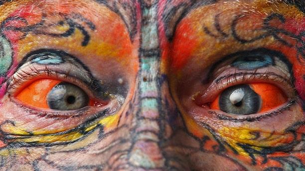 Authorities are considering banning eyeball tattoos in Washington state. (Getty)