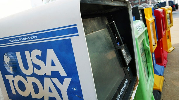 A USA Today newspaper dispenser is seen in St. Louis. (Getty Images)