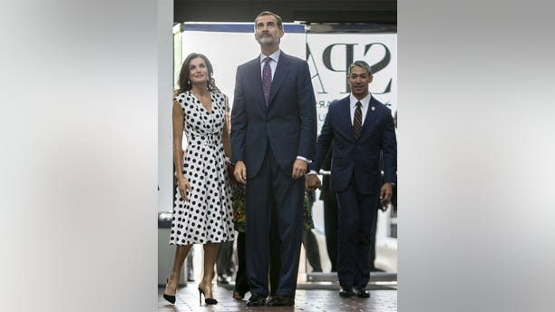 King Felipe the VI, center, and Queen Letizia of Spain arrive at the San Antonio Museum of Art, Monday, June 18, 2018, in San Antonio. San Antonio Mayor Ron Nirenberg, right, looks on.