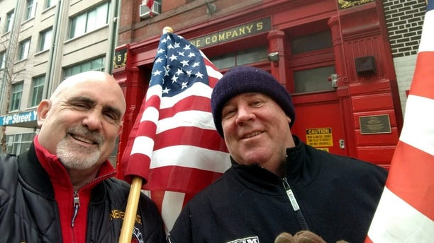 Chris Edwards, left, and Tom Lonegan, right, are retired New York City firefighters who responded to the 9-11 terrorist attack. They said theywanted to honor the American flag after seeing someone vandalize it.