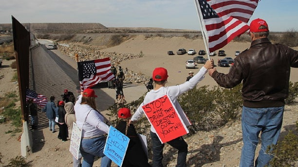 Supporters of the U.S. Republican Party make a human wall to demonstrate in favor of the construction of the border wall between the United States and Mexico, at the border between Sunland Park, New Mexico, United States and Ciudad Juarez, Chihuahua state, Mexico, on February 9, 2019. (Photo by Herika Martinez / AFP) (Photo credit should read HERIKA MARTINEZ/AFP/Getty Images)