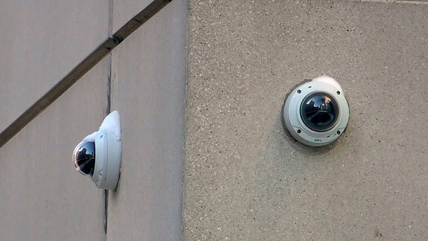 """In this Feb. 1, 2019 photo, surveillance cameras are seen near the spot where """"Empire"""" actor Jussie Smollett allegedly staged the attack in Chicago. Chicago police tapped into a vast network of surveillance cameras _ and some homeowners' doorbell cameras _ to help determine the identities of two brothers who later claimed they were paid by """"Empire"""" actor Jussie Smollett to stage a racist and homophobic attack. (AP Photo/Teresa Crawford)"""