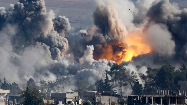 Smoke rises over Syrian town of Kobani after an airstrike, as seen from the Mursitpinar border crossing on the Turkish-Syrian border in the town of Suruc in this file October 18, 2014 file photo.